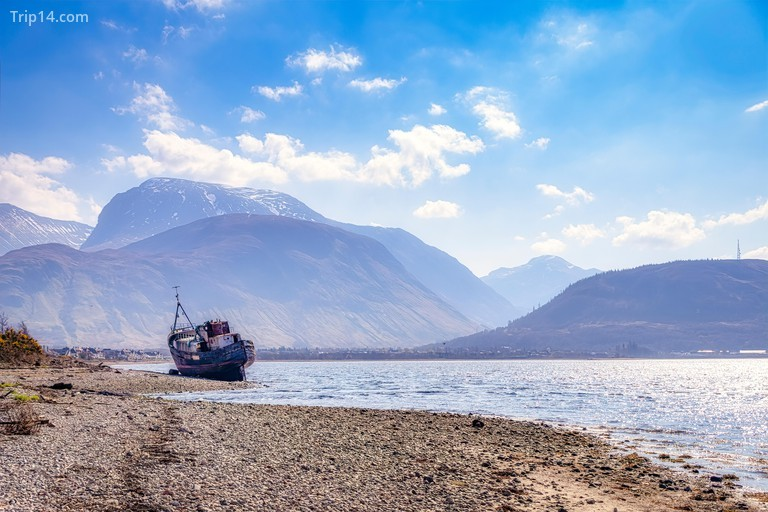 Shipwreck at Loch Linnhe with Ben Nevis and Fort William in background, Highlands, Scotland, UK
